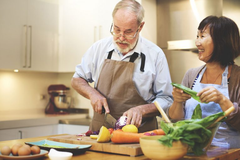 A old couple prepare for cooking food in kitchen